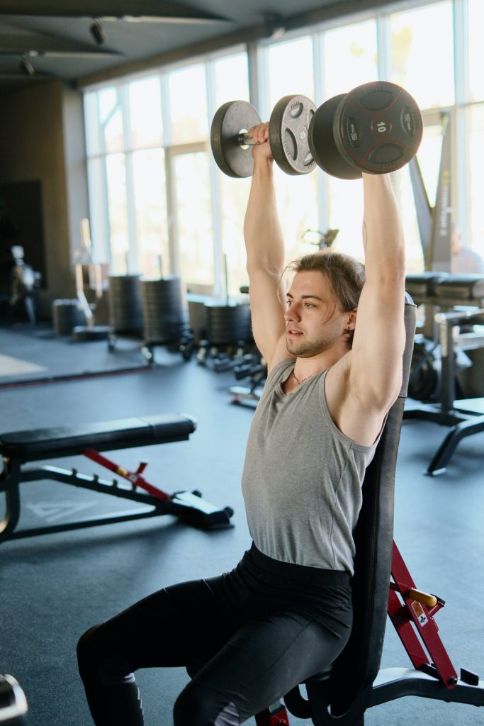 man using a weight bench