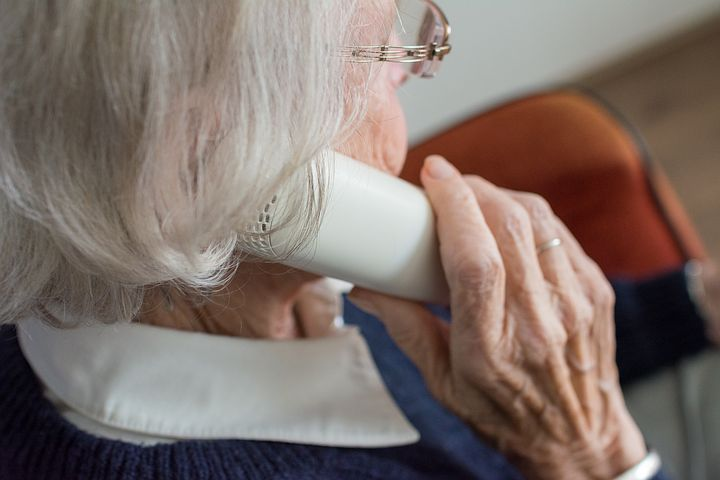 Old woman inquiring about aged care financial advice costs
