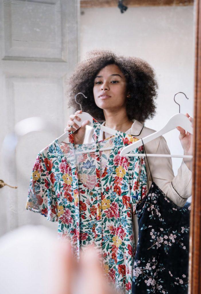 Woman choosing a dress to wear