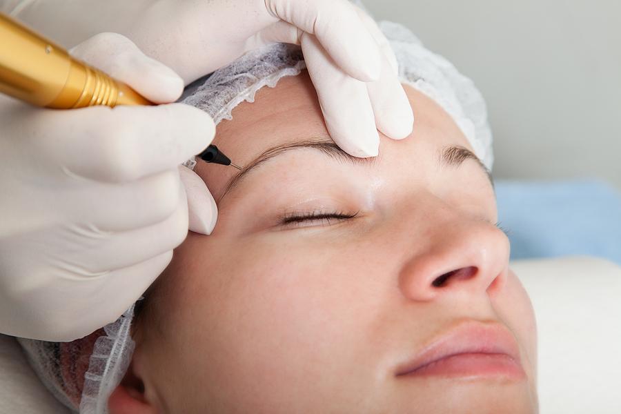 Woman undertaking an eyebrow tattoo in Sydney procedure