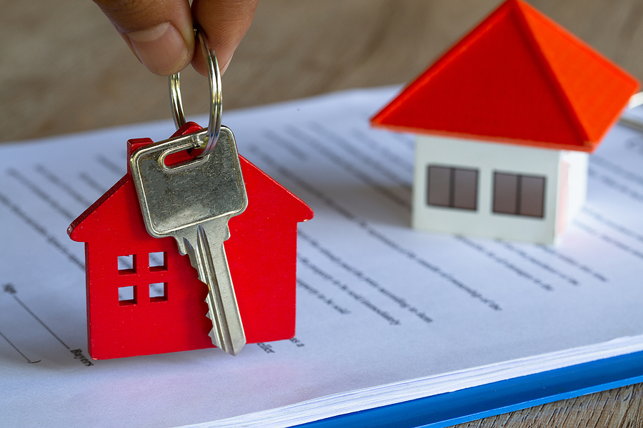 Home and a key. Real estate concept