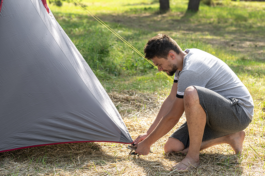 Man setting up a hiking tent