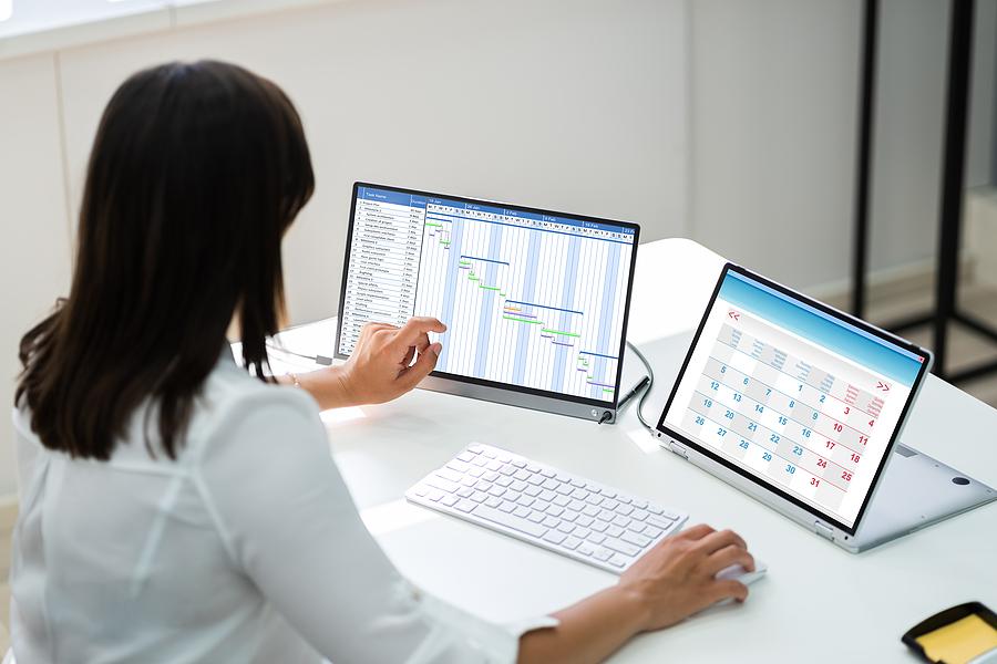 Female worker using timesheet management software